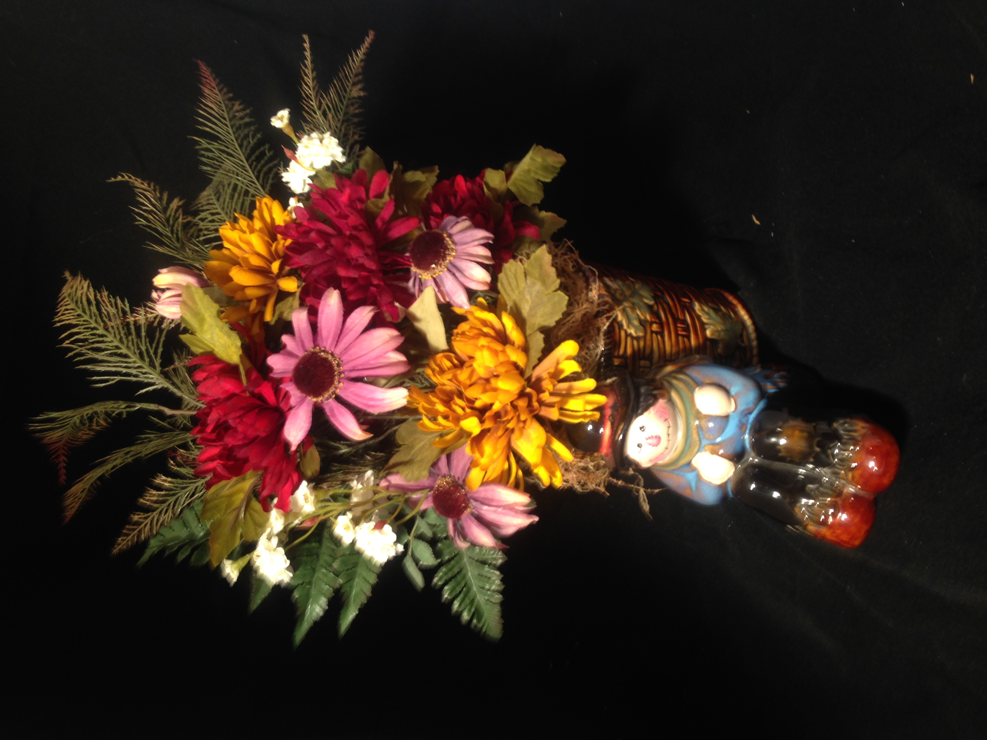 Floral arrangement scarecrow with basket vase