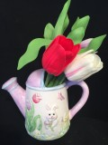 Tulips in rabbit water pitcher